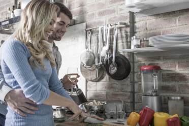 Couple cooking in kitchen - ZEF14444