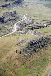 USA, Aerial of escarpments and cliffs bisected by a country road in Western Nebraska - BCDF00310