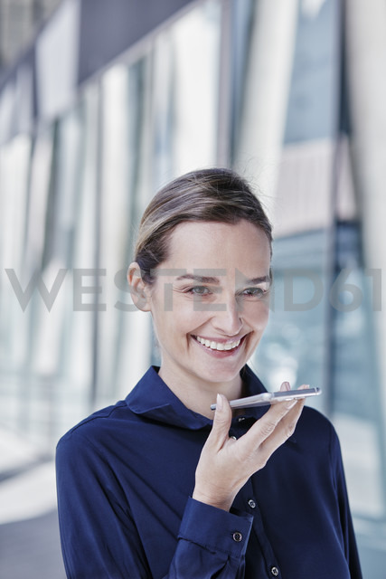 Portrait of smiling businesswoman using cell phone - RORF00988