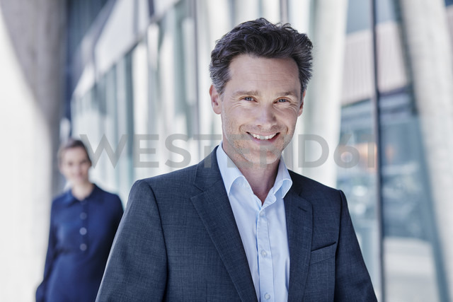 Portrait of smiling businessman - RORF00994