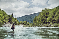 Slovenia, man fly fishing in Soca river - BMAF00308