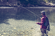 Slovenia, man fly fishing in Soca river - BMAF00317