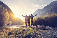 Slovenia, Bovec, three friends at Soca river at sunset - BMAF00329
