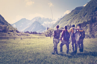 Slovenia, Bovec, four anglers standing on meadow near Soca river - BMAF00338
