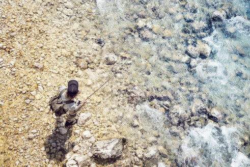 Slovenia, top view of man fly fishing in Soca river - BMAF00341