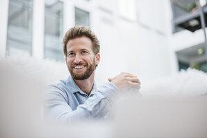 Portrait of smiling businessman - DIGF02736