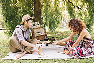 Happy couple having a picnic in a park - ALBF00167