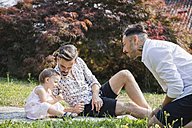 Gay couple playing with their child in the garden - MRAF00227