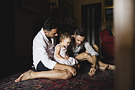 Gay couple playing with their little daughter at home - MRAF00236