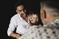 Happy gay couple playing with their little daughter at home - MRAF00239