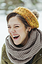 Portrait of laughing woman in the snow - ZEDF00801