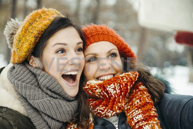 Two friends taking selfies in the snow - ZEDF00810