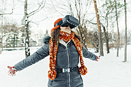 Woman wearing Virtual Reality Glasses in winter landscape - ZEDF00813