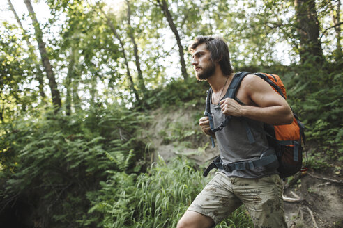 Young man hiking in forest - VPIF00023