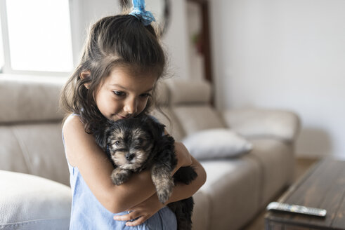 Little girl with her puppy at home - JASF01802
