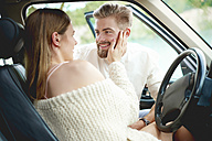 Affectionate young couple in car - ABIF00001