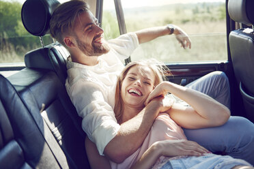 Happy young couple relaxing in car - ABIF00013