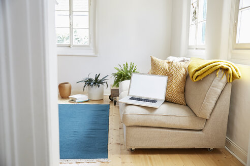 Laptop on couch in a modern living room of an old country house - PDF01270