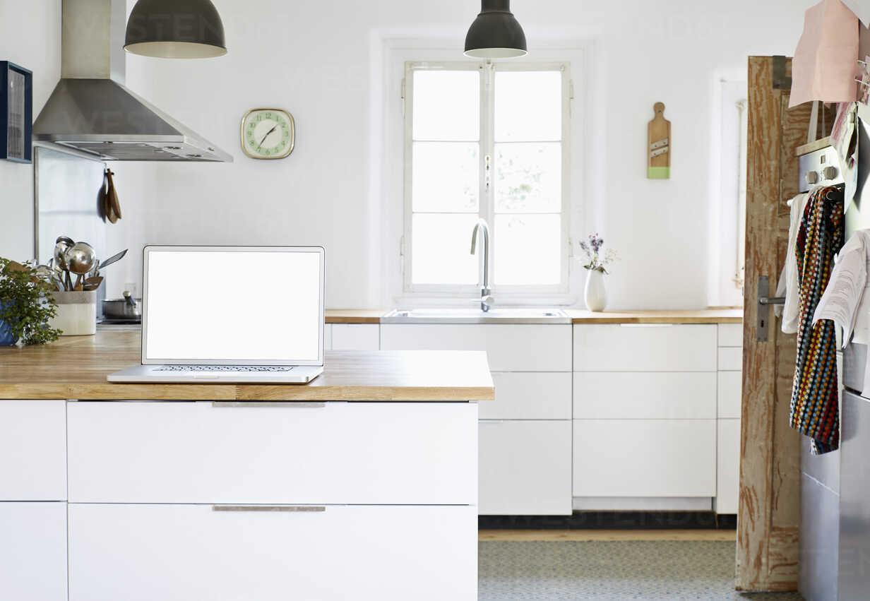 Laptop standing on worktop in a modern kitchen - PDF01276 - Philipp Dimitri/Westend61