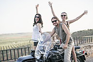 Portrait of three laughing bikers with their sidecar motorcycle - JASF01805