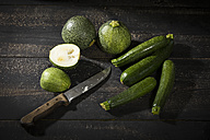 Eight ball squashes and courgettes on dark wood - MAEF12397