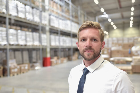 Portrait of confident businessman in warehouse - LYF00777