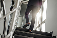 Legs of businessman walking upstairs - JOSF01496