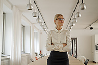 Confident businesswoman in conference room - JOSF01517