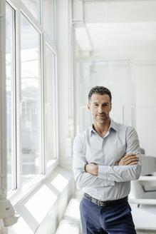 Portrait of confident businessman at the window - KNSF02448