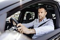 Businessman driving car - KNSF02466