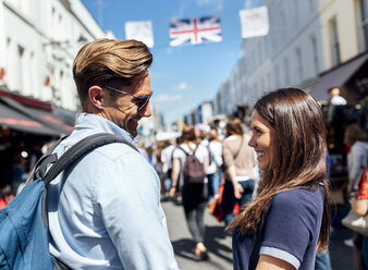 UK, London, Portobello Road, happy couple face to face - MGOF03584