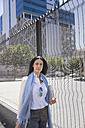 Businesswoman walking in the city - WESTF23537