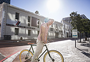 Mature man riding bicycle in the city - WESTF23579
