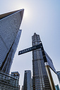 China, Shanghai, Lujiazui, skyscrapers and sign post at financial district - THAF01978