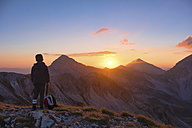 Italy, Abruzzo, Gran Sasso e Monti della Laga National Park, Portella Mountain, hiker watching sunset - LOMF00614