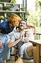 Happy couple with baby son together on balcony - SPFF00022