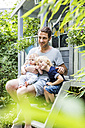 Portrait of mature man with his sons in the garden - SPFF00028