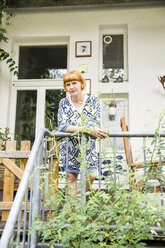Portrait of redheaded woman standing on balcony - SPFF00034