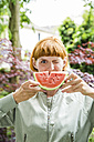 Portrait of winking woman holding slice of watermelon - SPFF00055