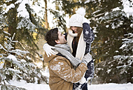 Happy young couple face to face in  snow-covered winter forest - HAPF02023