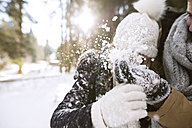 Playful young couple in winter - HAPF02029
