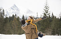 Happy young couple having fun in winter landscape - HAPF02041
