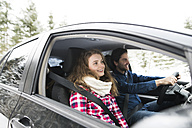 Young couple on a road trip in winter landscape - HAPF02065