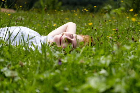 Teenage girl relaxing on a meadow - LBF01633