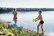 Children splashing with water at lakeshore - MJF02174
