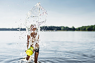 Boy splashing with water at lakeshore, close-up - MJF02180
