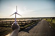 Hand holding miniature wind turbine - MOEF00090