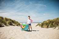 Girl with globe on the beach - MOEF00126