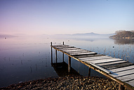 Italy, Piedmont, jetty at Lago Viverone at twilight - SIPF01667