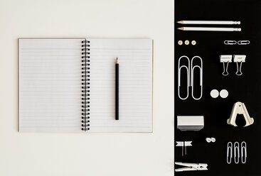 White office utensils on black background and notepad and pencil on whilte background - MELF00186